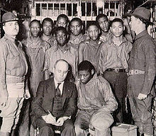 The Scottsboro Boys, with attorney Samuel Leibowitz, under guard by the state militia, 1932